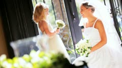 Beautiful Bride with Cute Flower Girl - stock footage