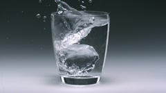 Stock Video Footage of Ice cube in glass of water, Slow Motion
