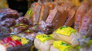 Caribbean bread stall at market Stock Footage