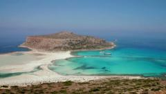 A crane shot over a rocky wall to the most beautiful Balos Bay of Crete, Greece - stock footage