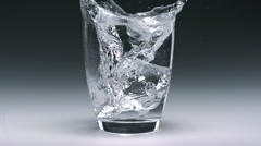 Ice cube in glass of water, Slow Motion - stock footage