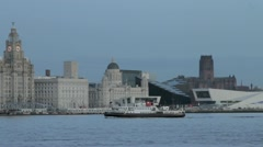 Mersey ferry crossing in front of Liver Buildings Stock Footage