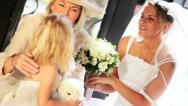 Cute Blonde Flower Girl Laughing Bride and Grandma Stock Footage