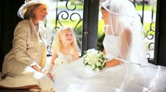 Pretty Caucasian Bride Young Girl Attendant and Grandmother Stock Footage