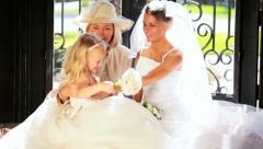 Cute Blonde Flower Girl Laughing Bride and Grandma - stock footage
