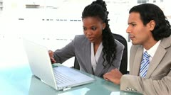 Business partners sitting with a laptop Stock Footage