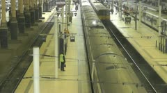 Overhead view of Train Departing from main railway station Stock Footage