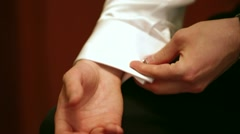 Man Adjusting Cuff Link Stock Footage