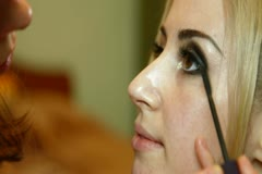 Stock Video Footage of Young Woman Having Mascara Applied