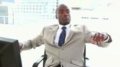 Black businessman resting on his chair Stock Footage