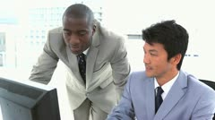 Colleagues working together on a computer Stock Footage