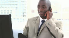 Businessman on the phone holding files - stock footage