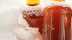 Beer left outside in snowy cold weather. Stock Footage