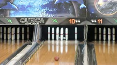 Bowling ball knocks over pins Stock Footage