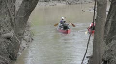 Stock Footage - Family in two canoes heading into river from creek Stock Footage