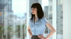 Smiling brunette businesswoman placing her hands on her hips Stock Footage