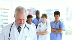 Happy medical team standing upright Stock Footage