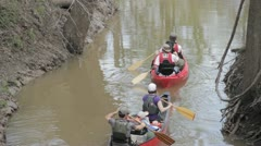 Stock Footage - Family in two canoes heading into river from creek - Med Shot Stock Footage