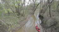 Stock Footage - Family in two canoes heading into river from creek - Wide Shot Stock Footage