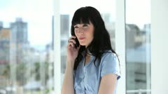 Cheerful businesswoman talking on the phone - stock footage