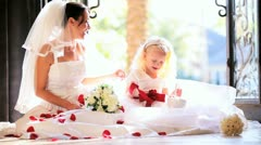 Beautiful Wedding Day Bride Sitting Playing Flower Girl Stock Footage