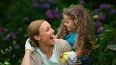 Mother and daughter gardening Stock Footage