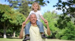 Man with his son on his shoulders Stock Footage