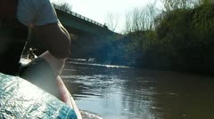 Stock Footage - Canoeing through river, going under bridge\over pass Stock Footage