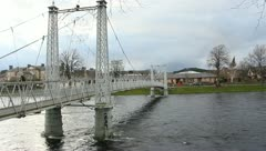 Suspension Bridge Over River Ness Inverness Scotland - stock footage