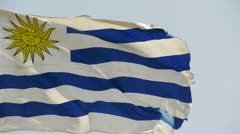 Uruguay flag is fluttering in wind. Stock Footage