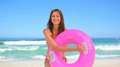 Smiling woman wearing an inflatable rubber ring Stock Footage