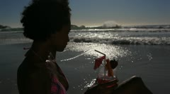 Woman drinking her cocktail with a straw Stock Footage