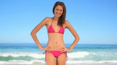 Happy brunette woman standing with her hands on her hips Stock Footage