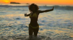 Happy woman dancing in the water Stock Footage
