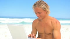 Happy blonde man holding his laptop Stock Footage