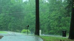 Rain falling in neighborhood Stock Footage