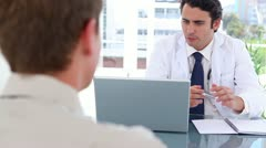 Happy black-haired doctor talking with his patient Stock Footage