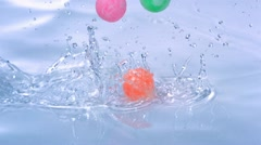 Bounce ball in water, Slow Motion Stock Footage