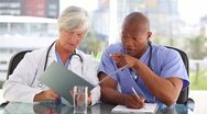 Happy medical team looking at documents Stock Footage