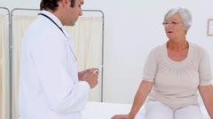 Serious doctor preparing a hypodermic needle Stock Footage