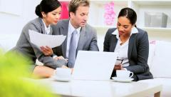 Multi Ethnic Business Team Using Wireless Technology - stock footage