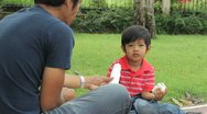 Cute Asian Boy Drinking Milk At The Park Stock Footage