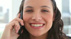 Businesswoman laughing during a phone call Stock Footage