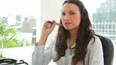 Businesswoman thinking while holding a pen Stock Footage