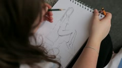 The artist paints naked girl on the paper Stock Footage