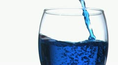 Blue trickle in super slow motion flilling a glass Stock Footage