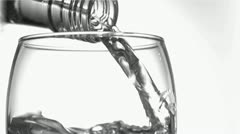 Close up, trickle of water in a super slow motion flowing of the glass Stock Footage