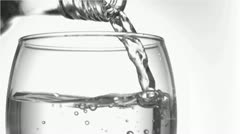 Trickle of water in a super slow motion finishing to serve of the glass Stock Footage