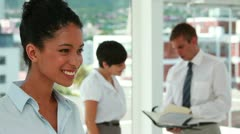 Portrait of a young woman with colleagues working Stock Footage