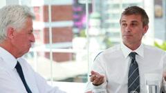 Businessmen talking together Stock Footage